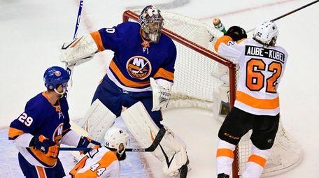Philadelphia Flyers right wing Nicolas Aube-Kubel (62) knocks