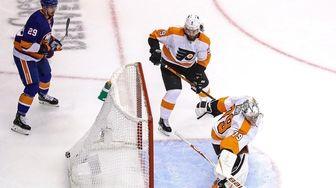 Carter Hart #79 of the Philadelphia Flyers allows