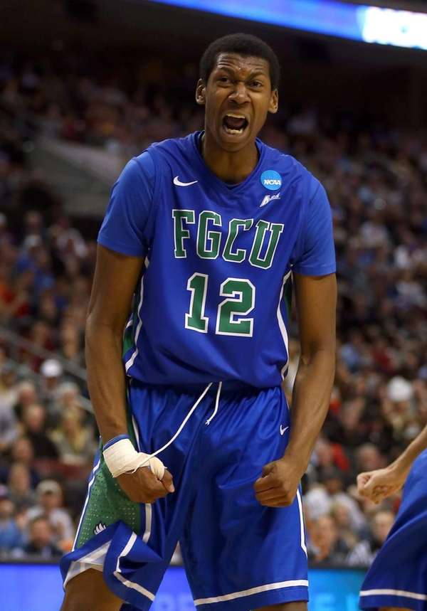 Florida Gulf Coast's Eric McKnight reacts after a