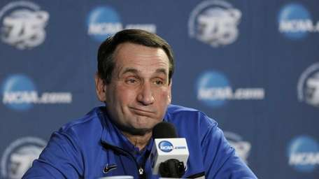 Duke head coach Mike Krzyzewski reacts during a