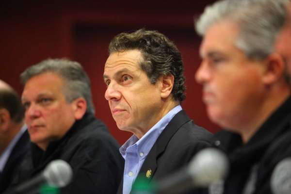 New York State Gov. Andrew M. Cuomo, center,