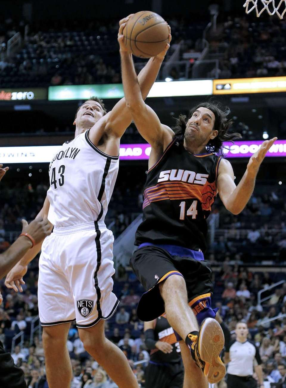 Kris Humphries and the Phoenix Suns' Luis Scola