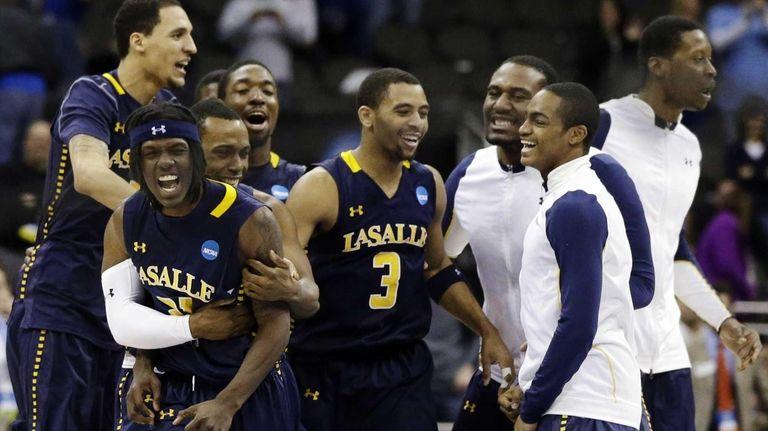 La Salle guard Tyrone Garland celebrates with teammates