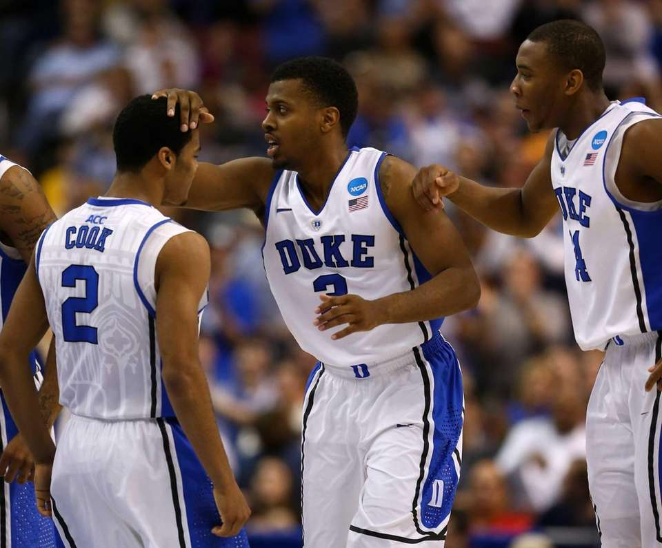 Duke's Tyler Thornton #3 celebrates with teammates Quinn