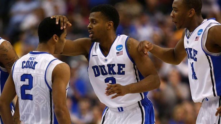 Duke's Tyler Thornton #3 celebrates with teammates Quinn