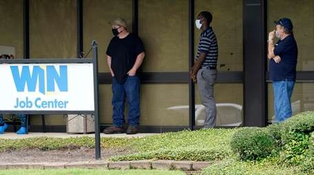 Job seekers line up outside the Mississippi Department