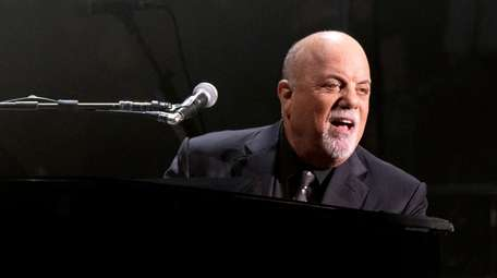 Billy Joel performs during a concert that also