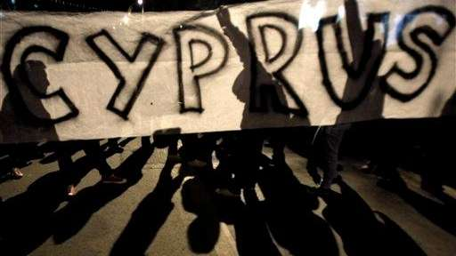 Protesters hold a banner during an anti-bailout rally
