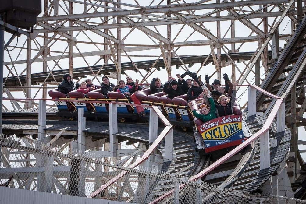 People ride the Brooklyn Cyclone during the ceremonial