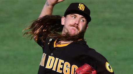 Mike Clevinger of the Padres pitches in the