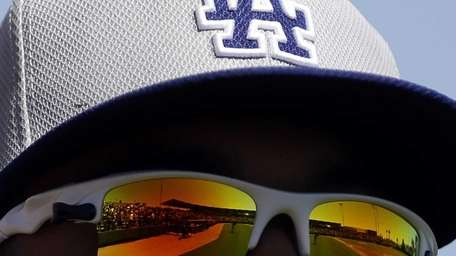 The field is reflected in the sunglasses of