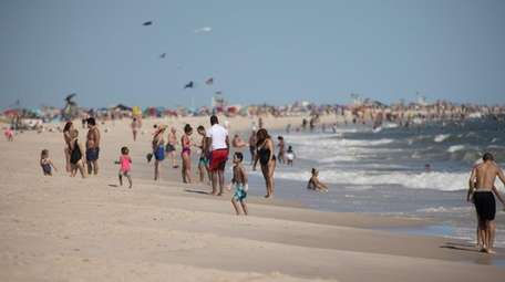 Swimmers enter the water at Jones Beach on