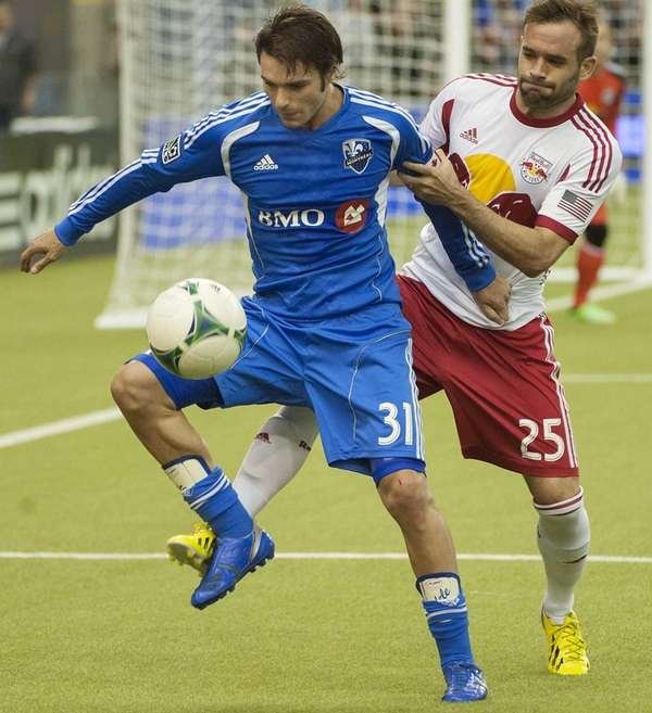 Montreal Impact's Andrea Pisanu battles for control of