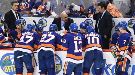 Islanders head coach Barry Trotz directs his players