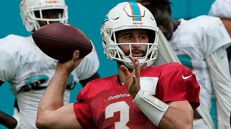 Josh Rosen of the Dolphins throws a pass