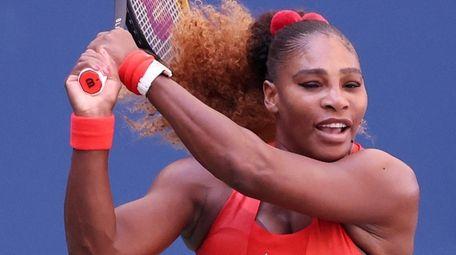 Serena Williams returns a shot during her women's