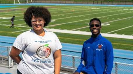 Angie Reyes and JonLuc Thompson are drum majors
