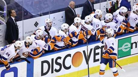 Andy Greene #4 of the Islanders is congratulated