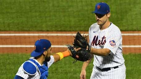 Mets starting pitcher Seth Lugo taps mitts with
