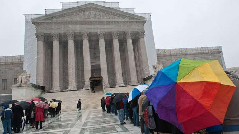 People queue to enter the Supreme Court in