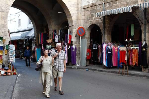 Tourists stroll through Casablanca, Morocco's Habous district that