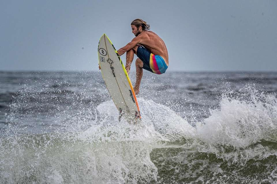 Lifeguard Hunter Rainis challenging the rough surfs at