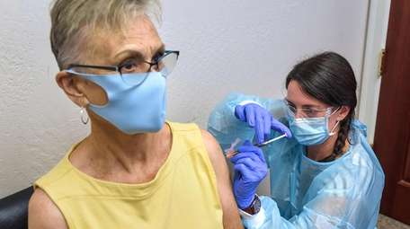 Volunteer Trish Malone is inoculated by study coordinator