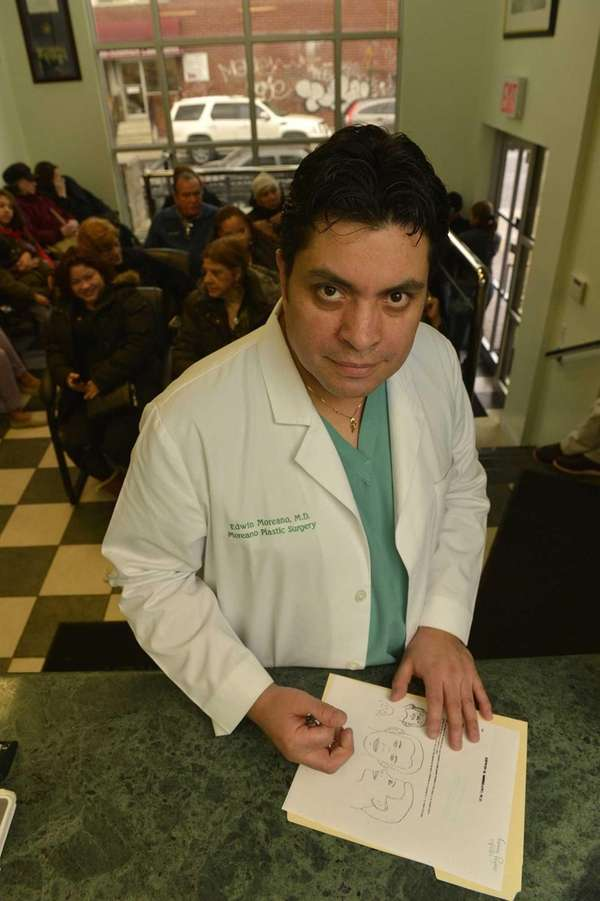 Dr. Edwin Moreano in his Jackson Heights office