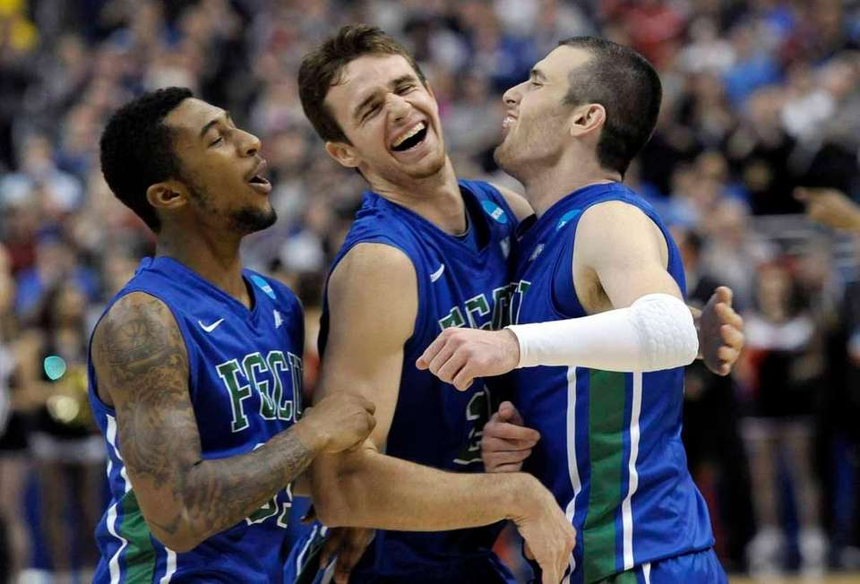 Florida Gulf Coast players celebrate after winning a