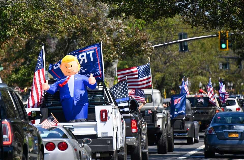 A inflatable of president Donald J. Trump passes