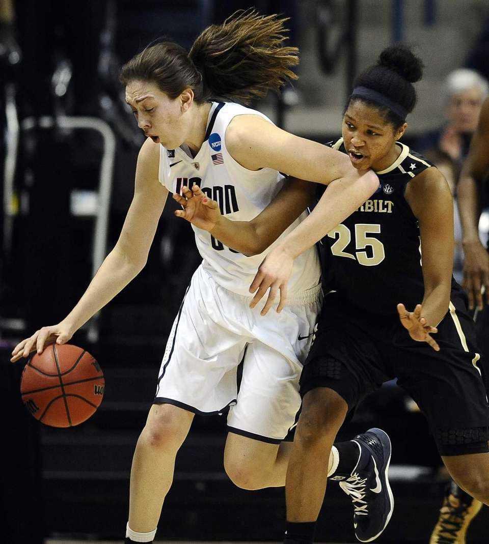 Connecticut's Breanna Stewart, left, drives past Vanderbilt's Morgan