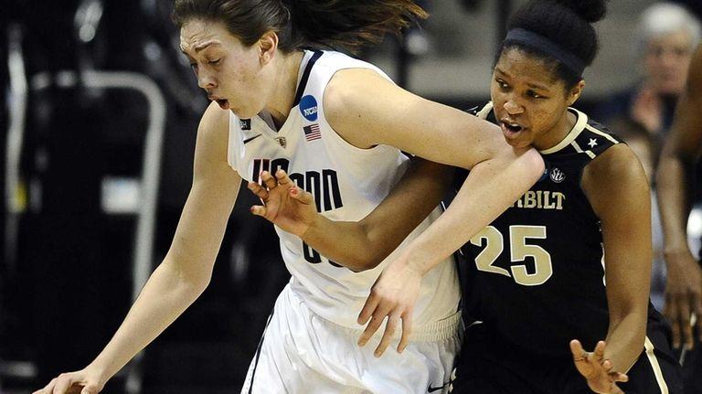 Connecticut's Breanna Stewart, left, drives past Vanderbilt's Morgan