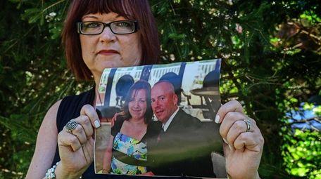 Deborah Mouradian holds a photo of her husband,