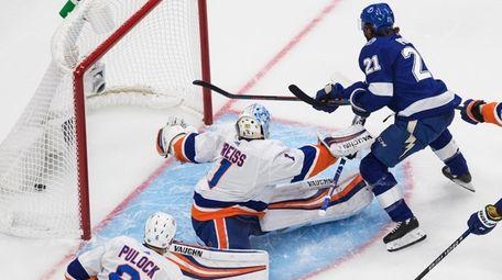 The Lightning's Brayden Point  scores on Islanders