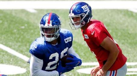 Saquon Barkley #26 of the Giants takes a