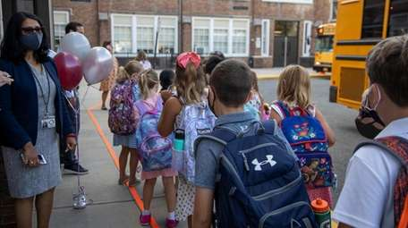 Students arrive at Stewart Elementary School in Garden