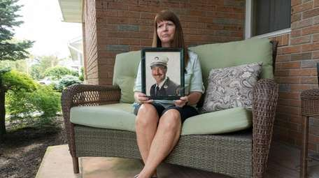 Ann Gismondi, with a portrait of her late