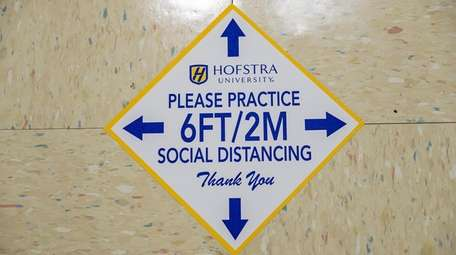 Social distancing reminders at Hofstra University in Uniondale.