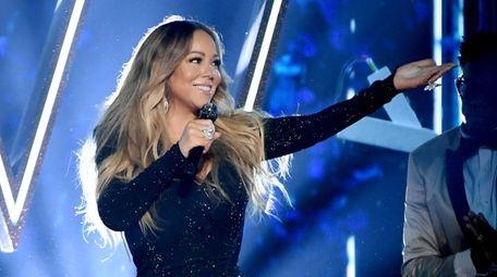 "The seven-song ""Mariah En Español"" is one of"