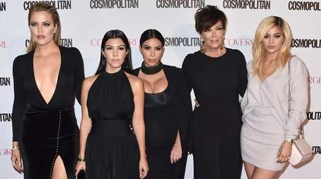 """""""Keeping Up with the Kardashians"""" stars Khloé, left,"""
