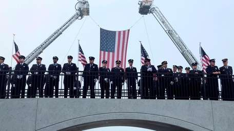 Firefighters line up at the 9/11 Memorial at