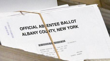 File photo, a box of absentee ballots wait