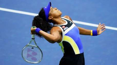 Naomi Osaka serves to Shelby Rogers during the