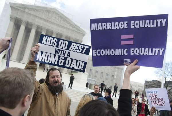 Same-sex marriage supporters talk with same-sex marriage opponents