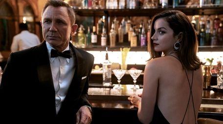 James Bond (Daniel Craig) and Paloma (Ana de