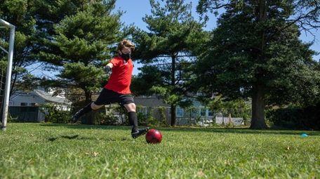 Sean Camberdella, 11, practices socially distanced soccer at