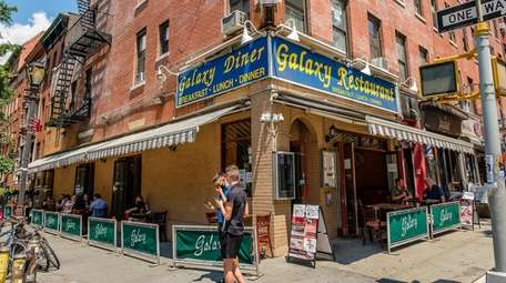 Customers enjoy lunch while seated outside at Galaxy