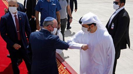 Israeli National Security Adviser Meir Ben-Shabbat, center left,