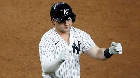 Luke Voit of the Yankees reacts after grounding