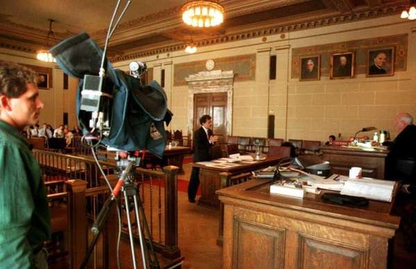 A camera monitors a trial in Albany in
